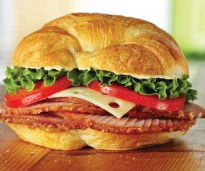 ham sandwich with lettuce, tomato, swiss cheese
