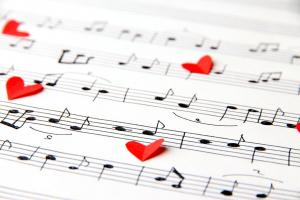 red paper hearts on music sheets