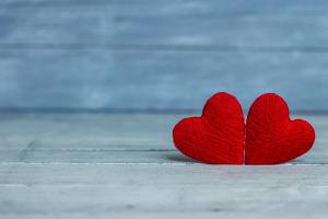 valentine's day - two woven hearts on blue background